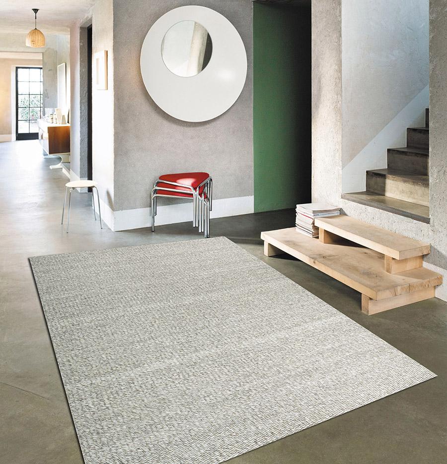 Benyt løse tæpper i indretning og skab hygge og ro